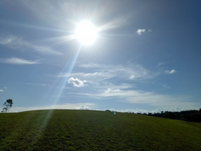 blue skies green field sunshine australia
