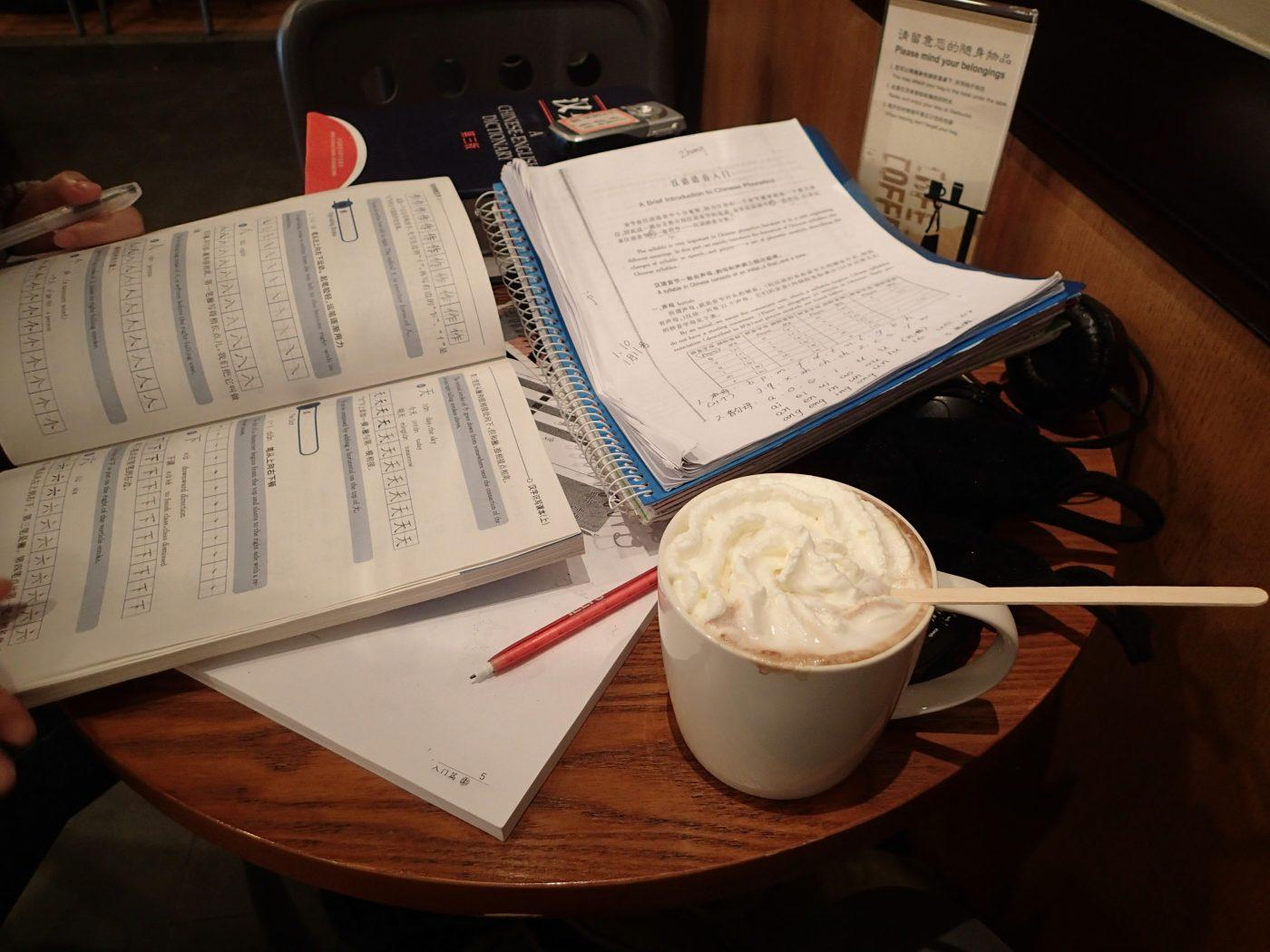 study books and starbucks coffee