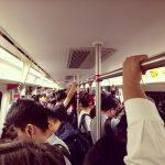 metro hands crowded train